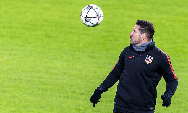 Atletico Madrid's Argentinian coach Diego Simeone controls a ball during a training session in Eindhoven on February 23, 2016 on the eve of the UEFA Champions League round of 16 first leg football match between PSV Eindhoven and Atletico Madrid. == NETHERLANDS OUT == / AFP / ANP / Jerry Lampen / Netherlands OUTJERRY LAMPEN/AFP/Getty Images