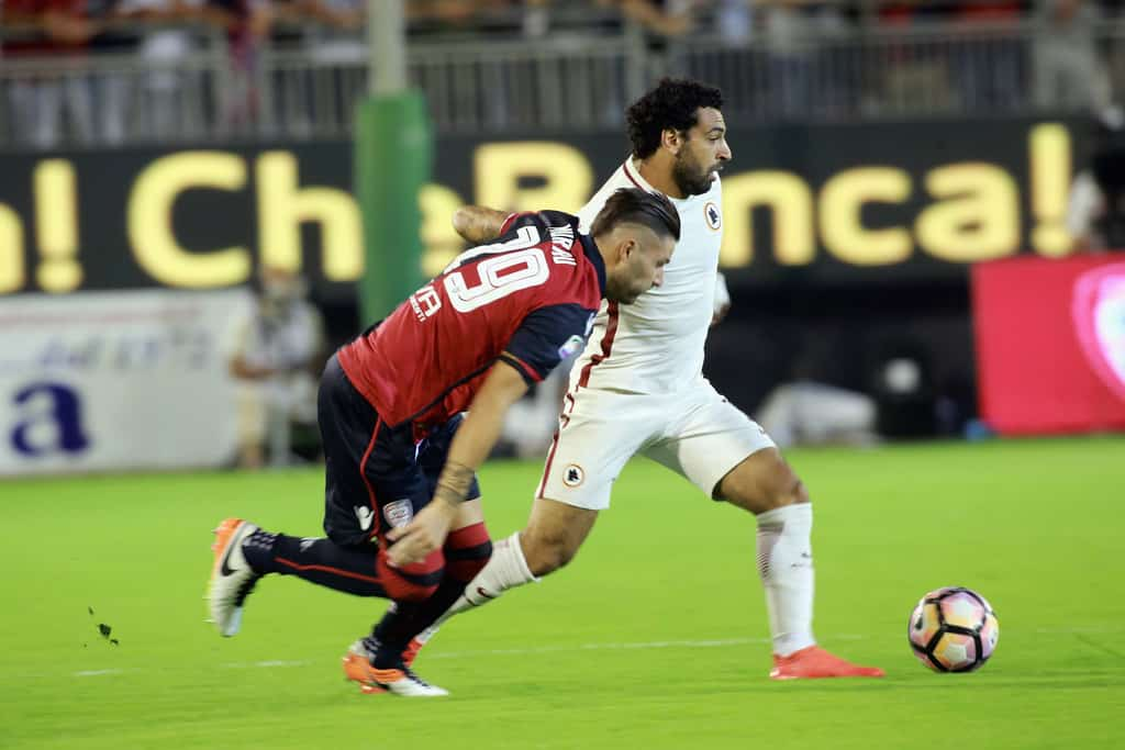 Nicola Murru of Cagliari and Mohamed Salah of Roma in contrast during the Serie A match between Cagliari Calcio and AS Roma at Stadio Sant'Elia on August 28, 2016 in Cagliari, Italy.