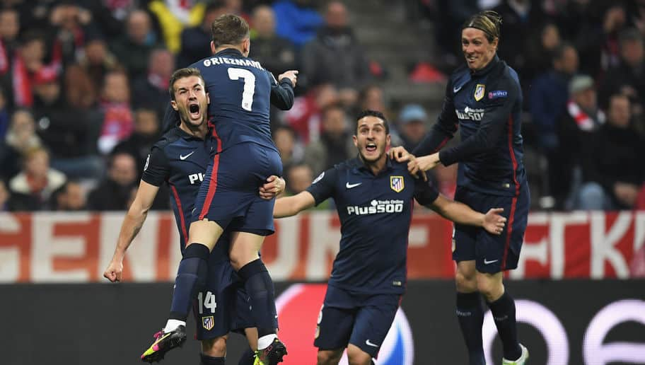 MUNICH, GERMANY - MAY 03: Antoine Griezmann of Atletico Madrid (7) celebrates with Gabi (L), Koke (2R) and Fernando Torres (R) as he scores their first goal during UEFA Champions League semi final second leg match between FC Bayern Muenchen and Club Atletico de Madrid at Allianz Arena on May 3, 2016 in Munich, Germany. (Photo by Matthias Hangst/Bongarts/Getty Images)