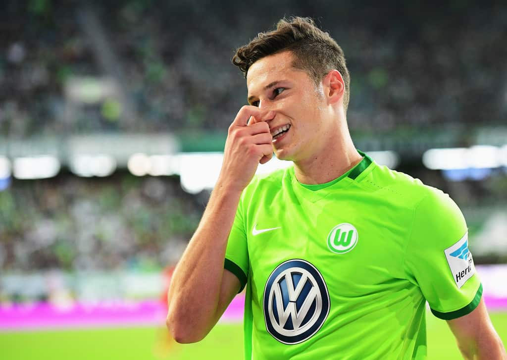 Wolfsburg playmaker Julian Draxler will be playing his football at one of Europe's leading clubs next season, according to his agent.