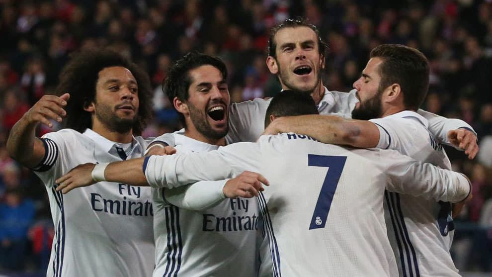 Real Madrid players celebrate Cristiano Ronaldo's goal against Atletico Madrid