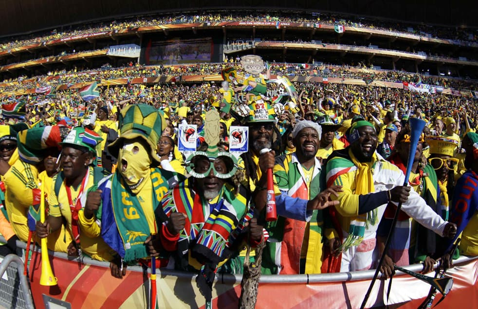South African soccer fans cheer prior to the World Cup group A soccer match between South Africa and Mexico at Soccer City in Johannesburg, South Africa, Friday, June 11, 2010. (AP Photo/ Ivan Sekretarev)