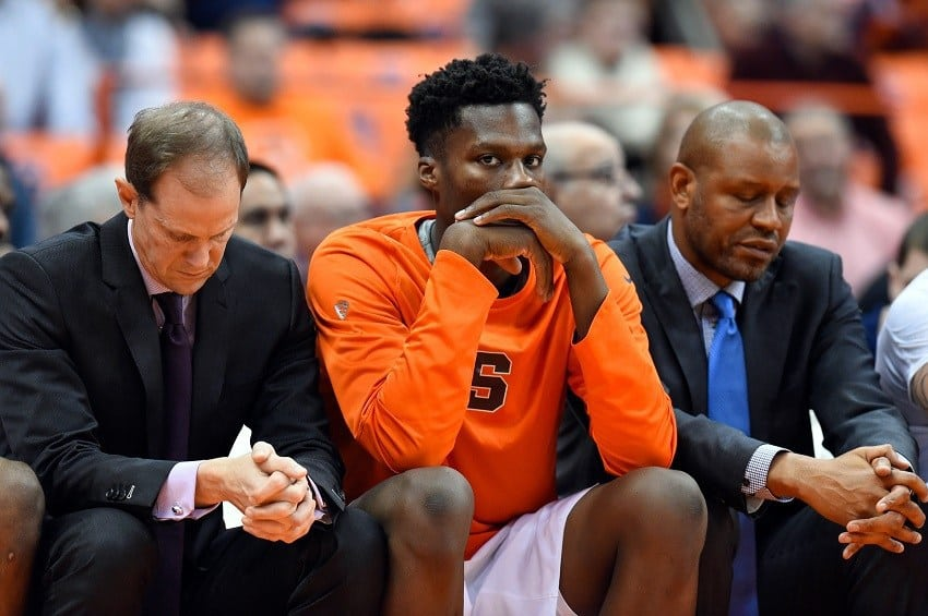 Dec 21, 2016; Syracuse, NY, USA; Syracuse Orange assistant coach Mike Hopkins (L) and forward Tyler Roberson (C) and assistant coach Adrian Autry (R) react from the bench against the St. John's Red Storm during the second half at the Carrier Dome. St. John's won 93-60. Mandatory Credit: Rich Barnes-USA TODAY Sports