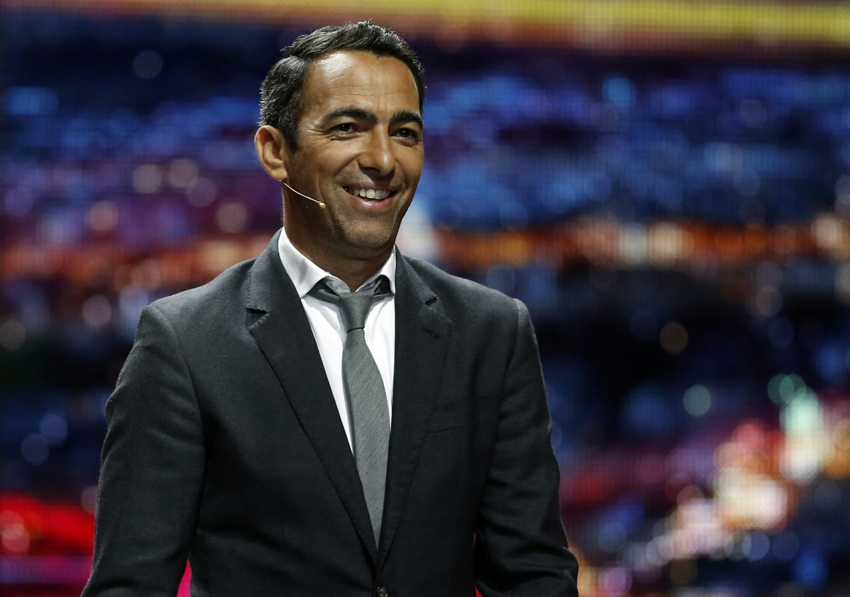 Former French forward Youri Djorkaeff arrives to hold the draw for the UEFA Europa League football competition's group stages in Monaco on