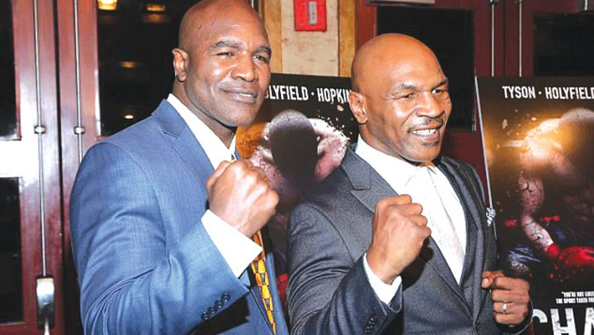 Mike Tyson and Evander Holyfield (Image - Guardian.ng)