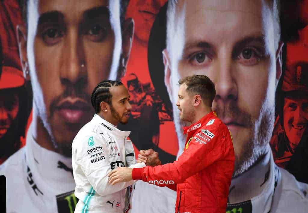 ace winner Lewis Hamilton of Great Britain and Mercedes GP and third placed finisher Sebastian Vettel of Germany and Ferrari in parc ferme during the F1 Grand Prix of China