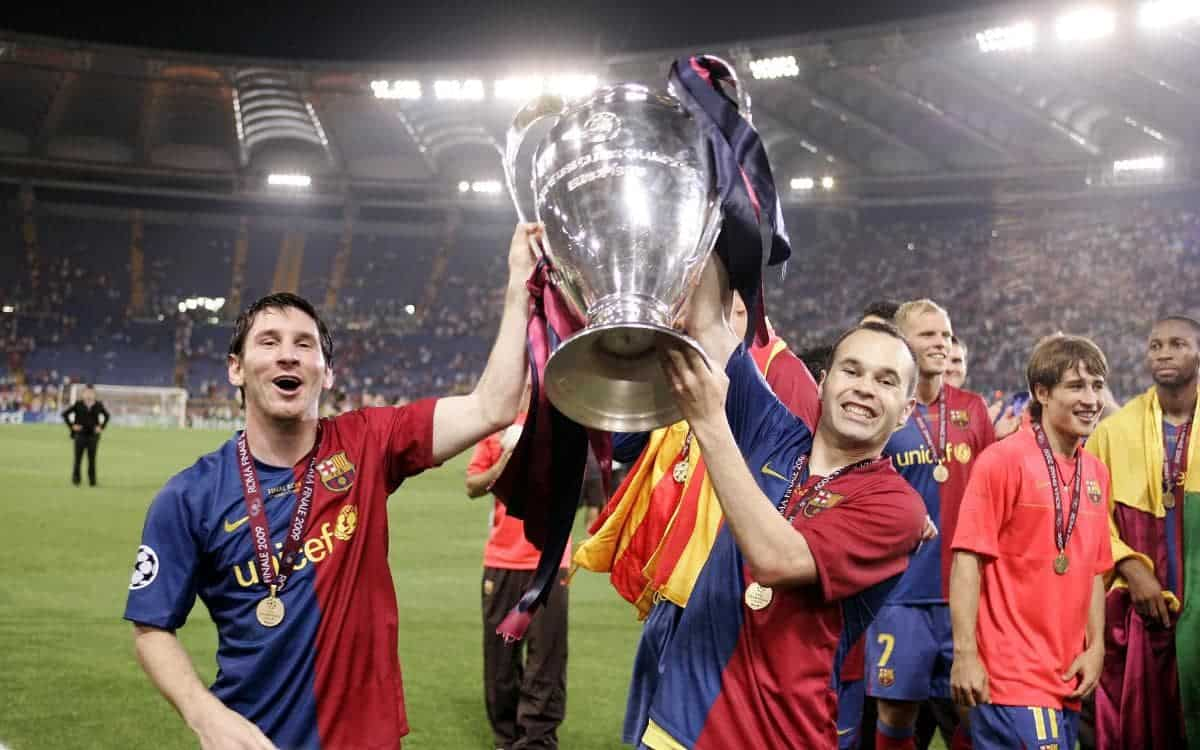 Lionel Messi and Andres Iniesta celebrating Champions League trophy