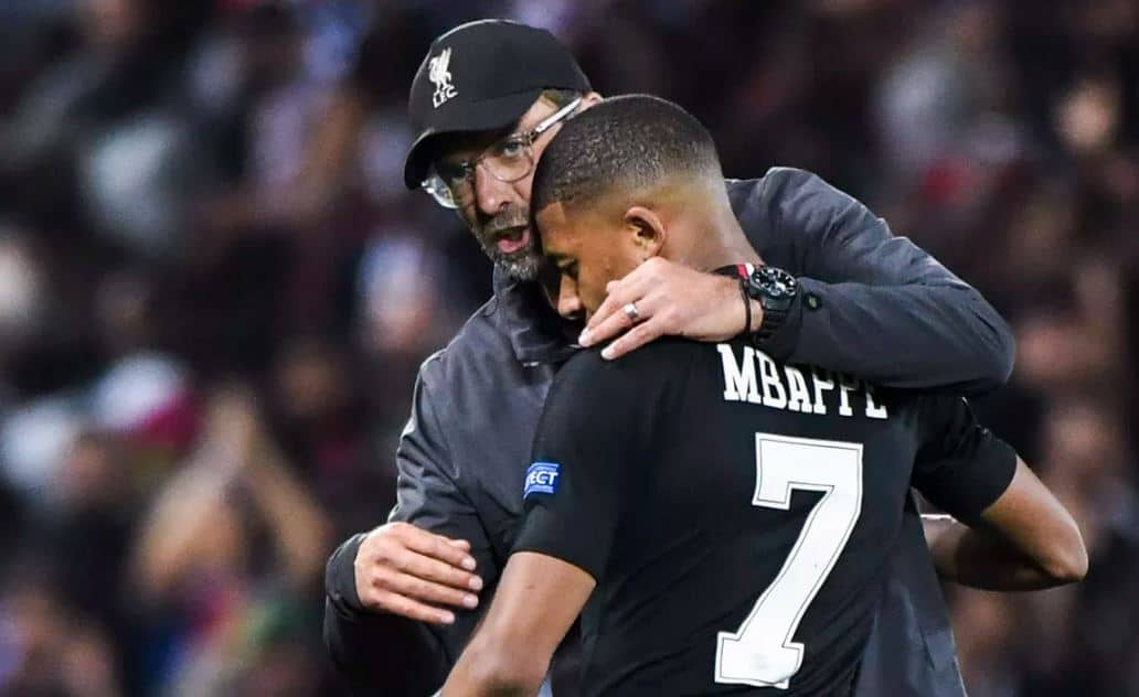Jurgen Klopp and Kylian Mbappe during Champions League clash between Liverpool and PSG