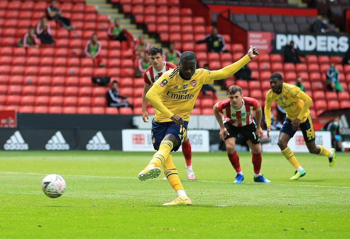Nicolas Pepe scores a penalty against Sheffield United in the FA Cup