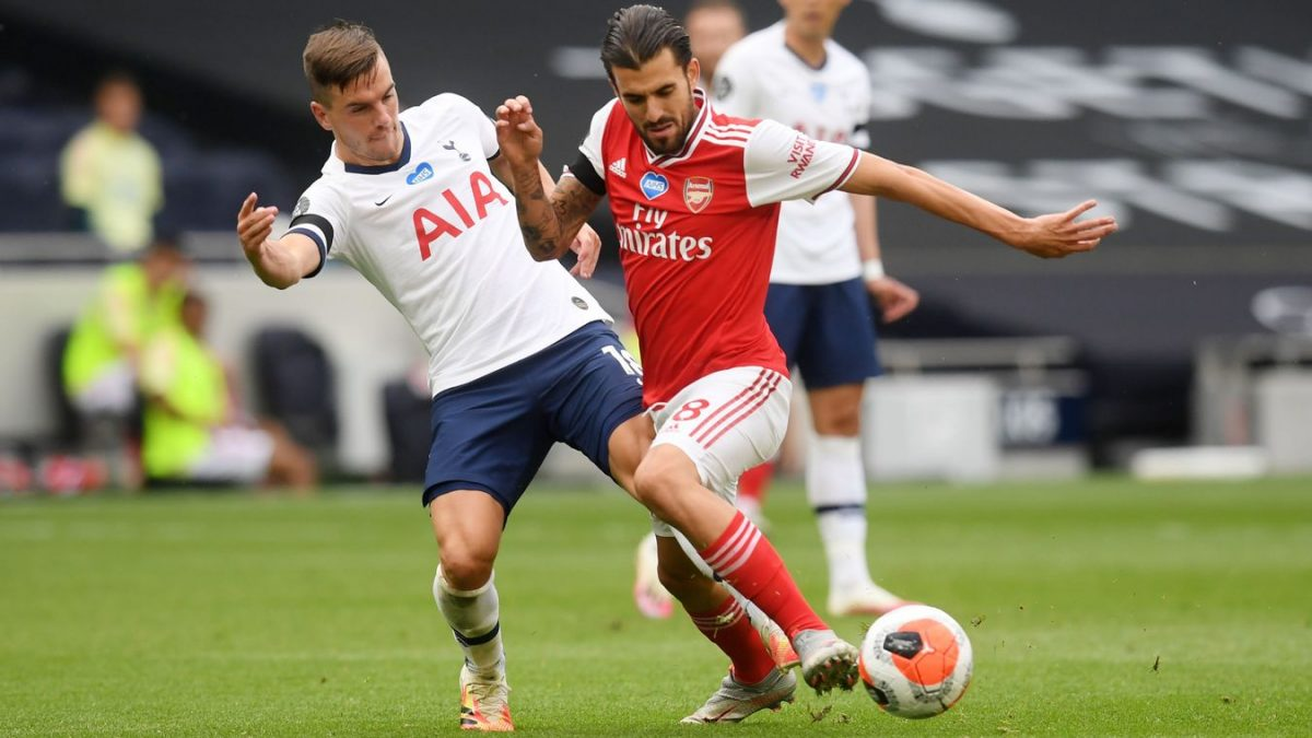 Spurs midfielder Giovani Lo Celso challenges Arsenal's Dani Ceballos during the early stages of the second half