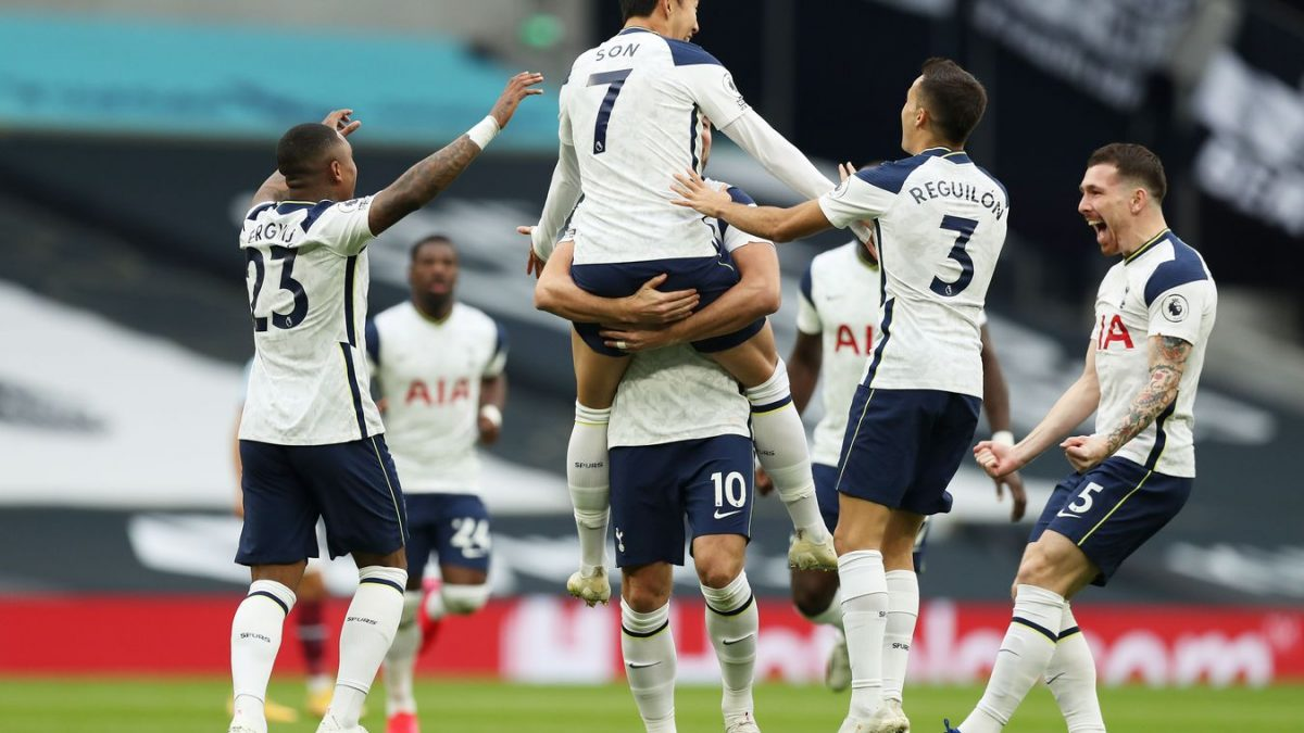 The Spurs players celebrate Son Heung-min's opener, as they get off to the best possible start against the Hammers