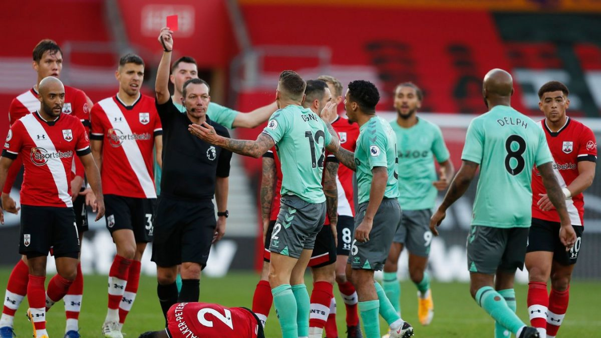 Lucas Digne is shown a straight red card by referee Kevin Friend after a foul on Kyle Walker-Peters