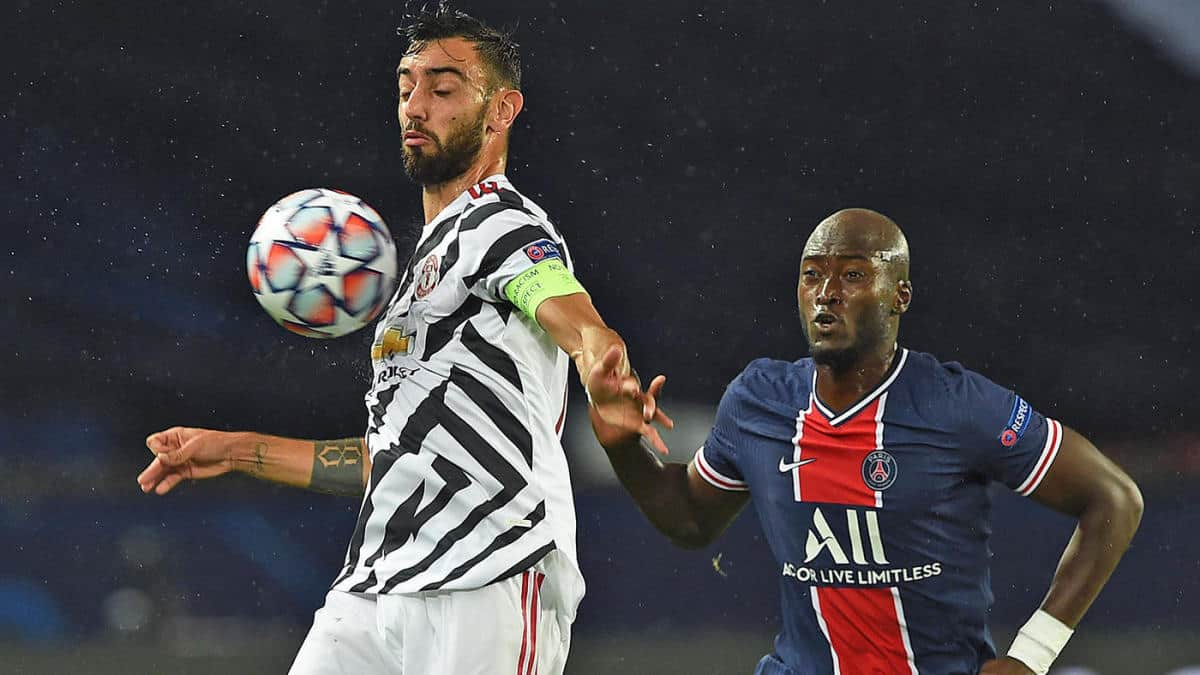 Bruno Fernandes of Manchester United is put under pressure by Danilo Pereira of Paris Saint-Germain during the UEFA Champions League Group H stage match between Paris Saint-Germain and Manchester United at Parc des Princes on October 20, 2020 in Paris, France. Sporting stadiums around Europe remain under strict restrictions due to the Coronavirus Pandemic as Government social distancing laws prohibit fans inside venues resulting in games being played behind closed doors. (Photo by Chris Ricco - UEFA/UEFA via Getty Images)