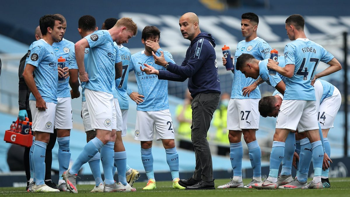 Manchester City players with Pep Guardiola