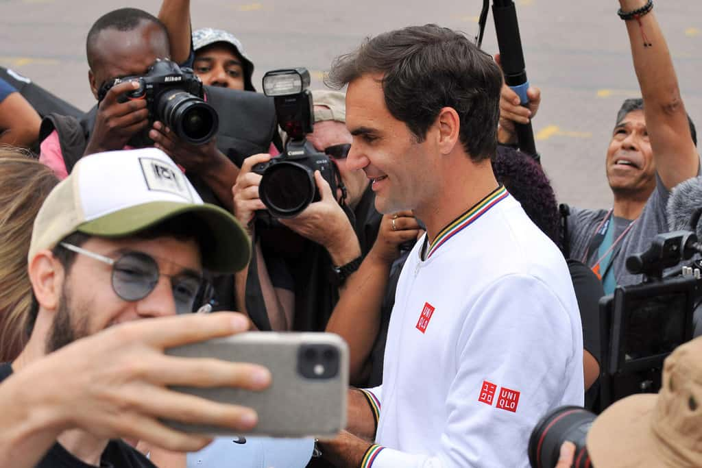 """Roger Federer signs autographs during the """"Match in Africa"""" photoshoot at Grand Parade on February 7, 2019 in Cape Town, South Africa."""