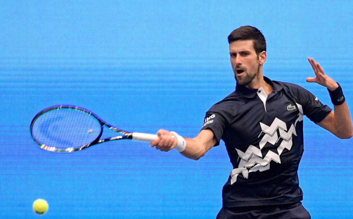 Novak Djokovic of Serbia plays a forehand during his quarter finals match against Lorenzo Sonego