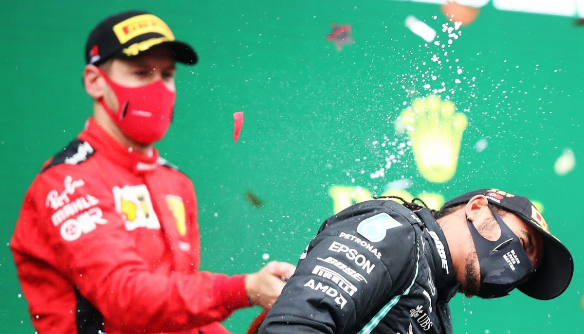 Race winner Lewis Hamilton of Great Britain and Mercedes GP celebrates winning a 7th F1 World Drivers Championship with Third placed Sebastian Vettel of Germany and Ferrari