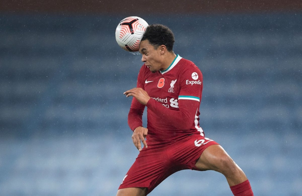 Trent Alexander-Arnold of Liverpool heads the ball during the Premier League match