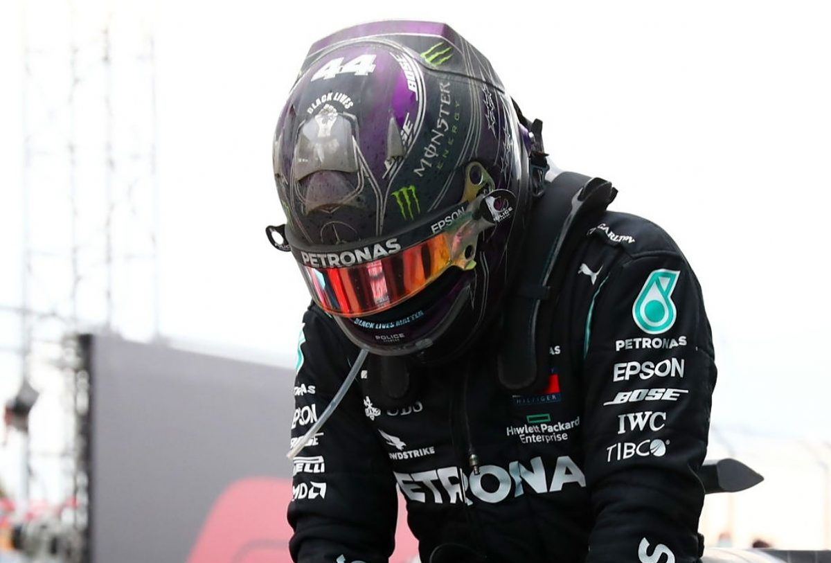 Race winner Lewis Hamilton of Great Britain and Mercedes GP celebrates winning a 7th F1 World Drivers Championship