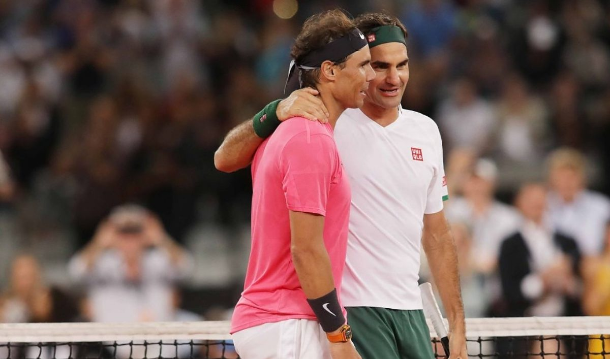Roger Federer (R) of Switzerland and Rafael Nadal (L) of Spain play a tennis match at Cape Town Stadium