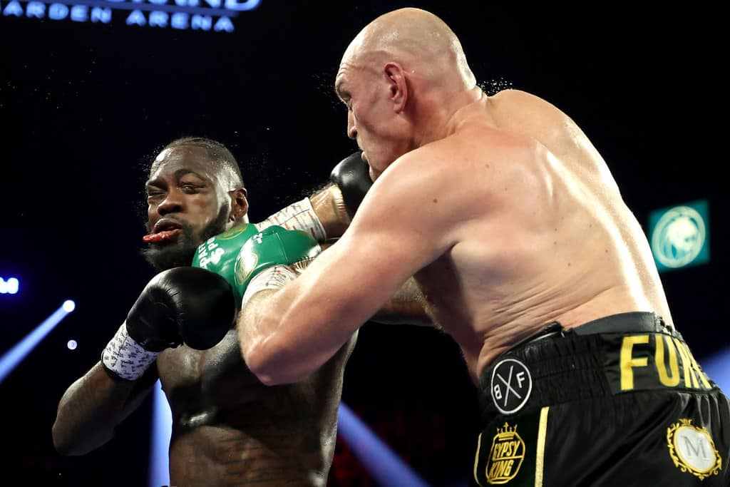 Tyson Fury (R) punches Deontay Wilder during their Heavyweight bout for Wilder's WBC and Fury's lineal heavyweight title on February 22, 2020 at MGM Grand Garden Arena in Las Vegas, Nevada.