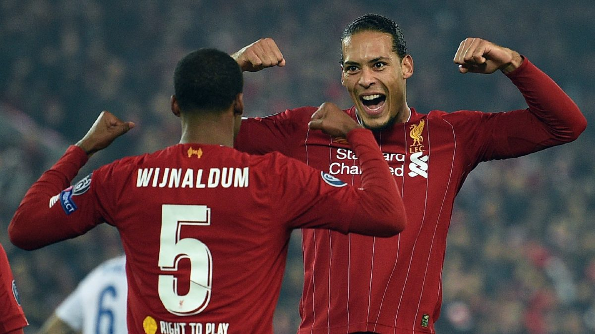 Liverpool's Dutch midfielder Georginio Wijnaldum (L) celebrates scoring with Liverpool's Dutch defender Virgil van Dijk during the UEFA Champions League group E football match between Liverpool and RC Genk at Anfield in Liverpool, north west England on November 5, 2019.