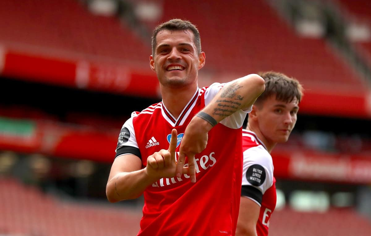 Granit Xhaka of Arsenal celebrates scoring his teams second goal during the Premier League match between Arsenal FC and Norwich City at Emirates Stadium on July 01, 2020 in London, United Kingdom