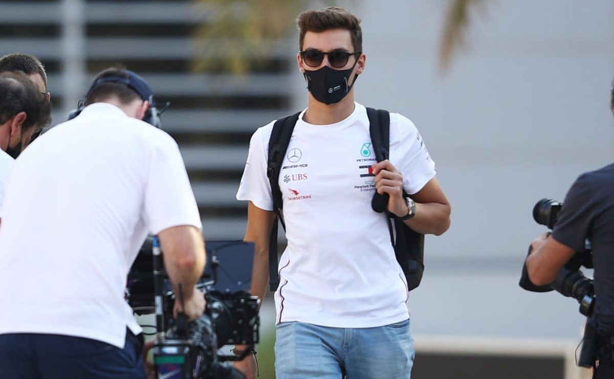 George Russell of Great Britain and Mercedes GP walks in the Paddock