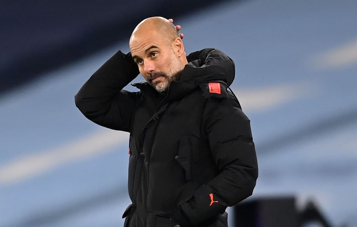 Pep Guardiola, Manager of Manchester City reacts during the Premier League match between Manchester City and Fulham