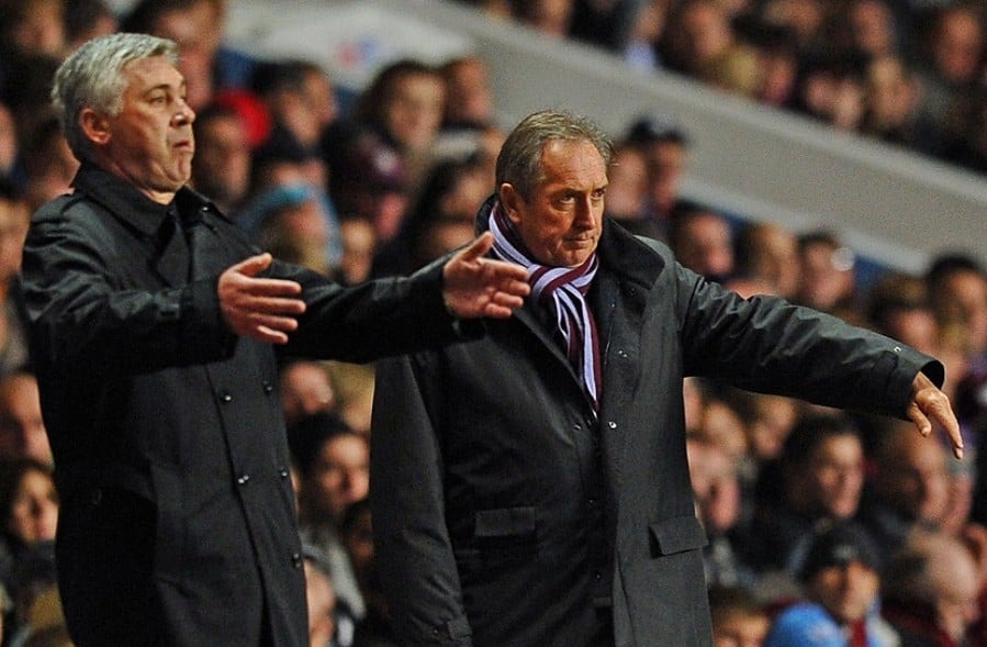 Aston Villa's French manager Gerard Houllier (R) and Chelsea's Italian manager Carlo Ancelotti gesture during the English Premier League football match between Aston Villa and Chelsea at Villa Park, Birmingham, West Midlands, England, on October 16, 2010. AFP PHOTO/PAUL ELLIS FOR EDITORIAL USE ONLY Additional licence required for any commercial/promotional use or use on TV or internet (except identical online version of newspaper) of Premier League/Football League photos. Tel DataCo +44 207 2981656. Do not alter/modify photo. (Photo credit should read PAUL ELLIS/AFP via Getty Images)
