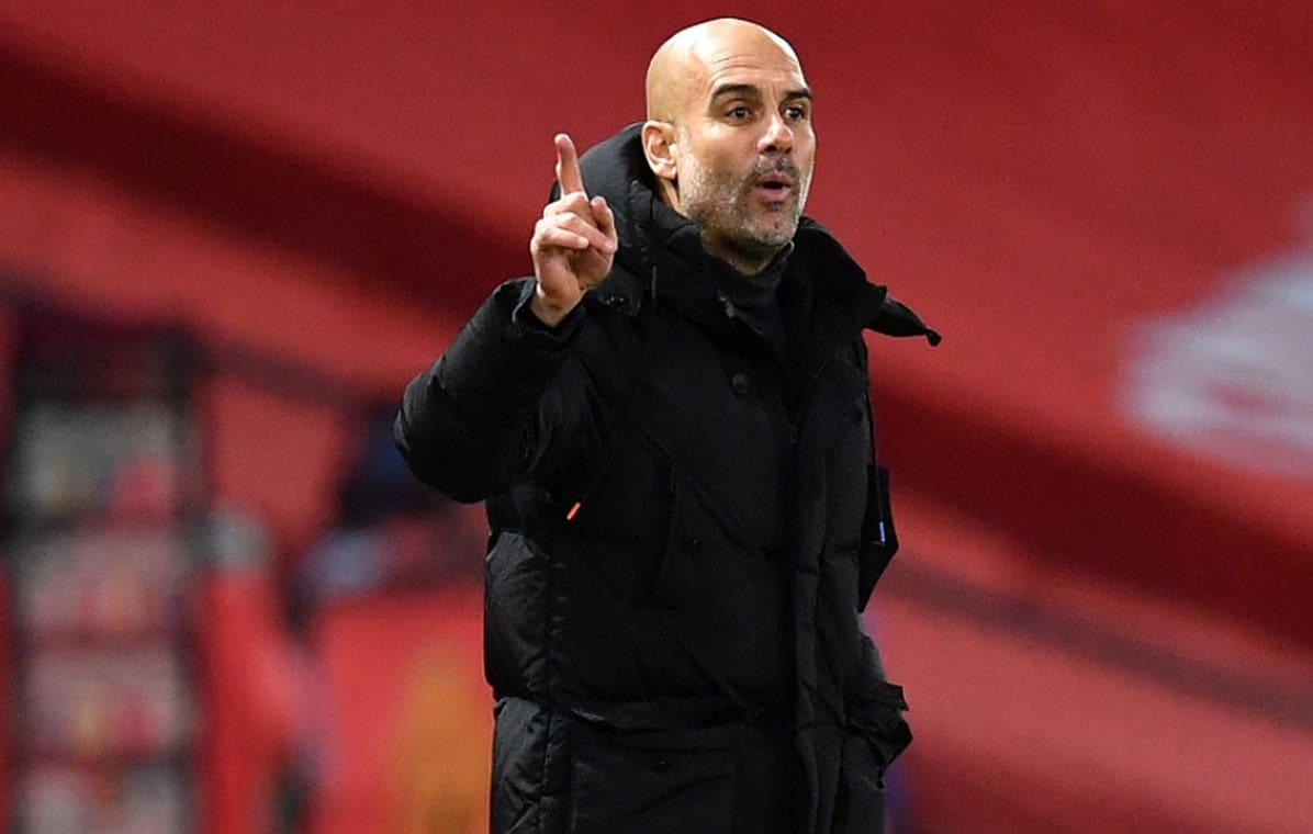 Manchester City manager Pep Guardiola instructs his players during the Premier League match at Old Trafford, Manchester. (Photo by Paul Ellis/PA Images via Getty Images)