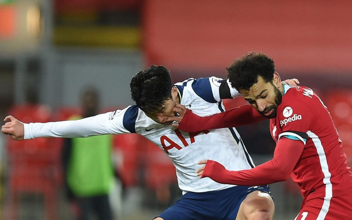 Mohamed Salah of Liverpool with Tottenham Hotspur's Son Heung-Min during the Premier League match between Liverpool and Tottenham Hotspur at Anfield on December 16, 2020 in Liverpool, England. A limited number of fans (2000) are welcomed back to stadiums to watch elite football across England. This was following easing of restrictions on spectators in tiers one and two areas only.(THE SUN OUT,THE SUN ON SUNDAY OUT ) (Photo by John Powell/Liverpool FC via Getty Images)