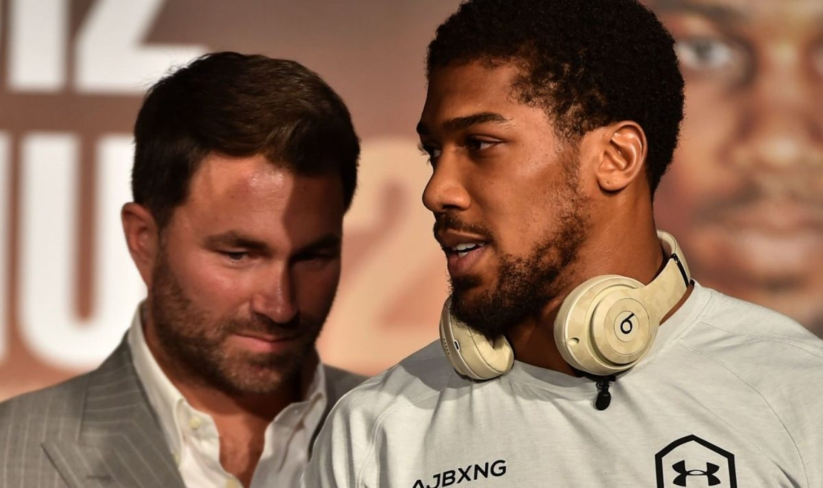 """Mexican-American heavyweight boxing champion Andy Ruiz Jr (L) Eddie Hearn (C) and British heavyweight boxing challenger Anthony Joshua (R) are pictured during their press conference in Ad Diriyah, a Unesco-listed heritage site, outside Riyadh, on December 4, 2019, ahead of the upcoming """"Clash on the Dunes"""". - The hotly-anticipated rematch between Ruiz Jr and British challenger Anthony Joshua is scheduled to take place in Diriya, near the Saudi capital on December 7. (Photo by FAYEZ NURELDINE / AFP) (Photo by FAYEZ NURELDINE/AFP via Getty Images)"""