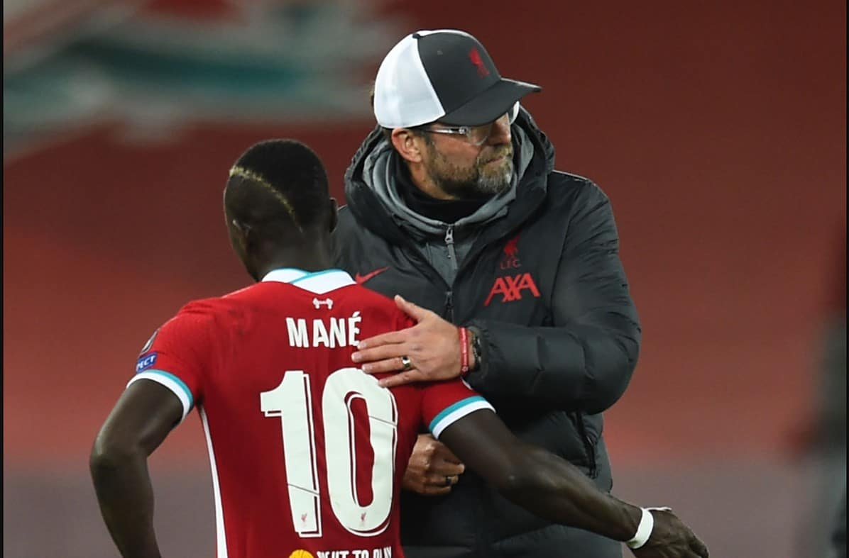 Jurgen Klopp manager of Liverpool with Sadio Mane of Liverpool at the end of the UEFA Champions League Group D stage match between Liverpool FC and Atalanta BC at Anfield on November 25, 2020 in Liverpool, England. Sporting stadiums around the UK remain under strict restrictions due to the Coronavirus Pandemic as Government social distancing laws prohibit fans inside venues resulting in games being played behind closed doors. (Photo by Andrew Powell/Liverpool FC via Getty Images)