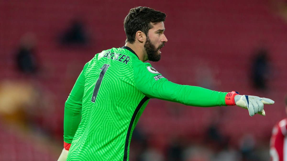 Alisson Becker in action for Liverpool against Manchester United