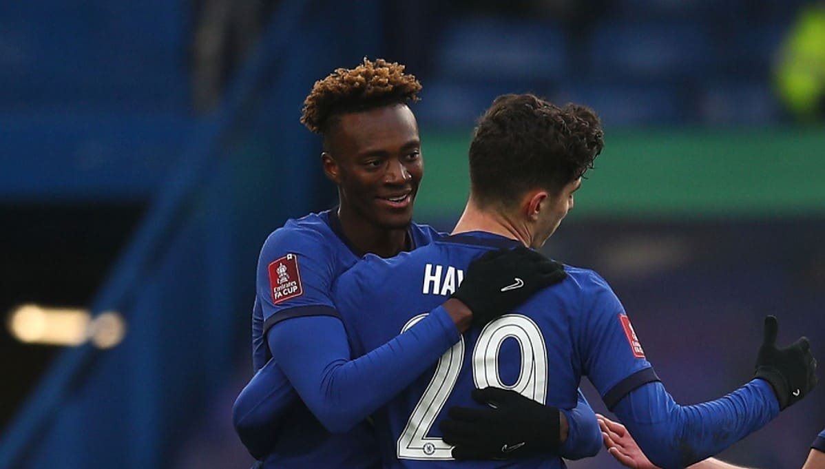 LONDON, ENGLAND - JANUARY 10: Kai Havertz of Chelsea celebrates with team mates (L - R) Tammy Abraham and Cesar Azpilicueta after scoring their side's fourth goal during the FA Cup Third Round match between Chelsea and Morecombe at Stamford Bridge on January 10, 2021 in London, England. Sporting stadiums around England remain under strict restrictions due to the Coronavirus Pandemic as Government social distancing laws prohibit fans inside venues resulting in games being played behind closed doors. (Photo by Chris Lee - Chelsea FC/Chelsea FC via Getty Images)