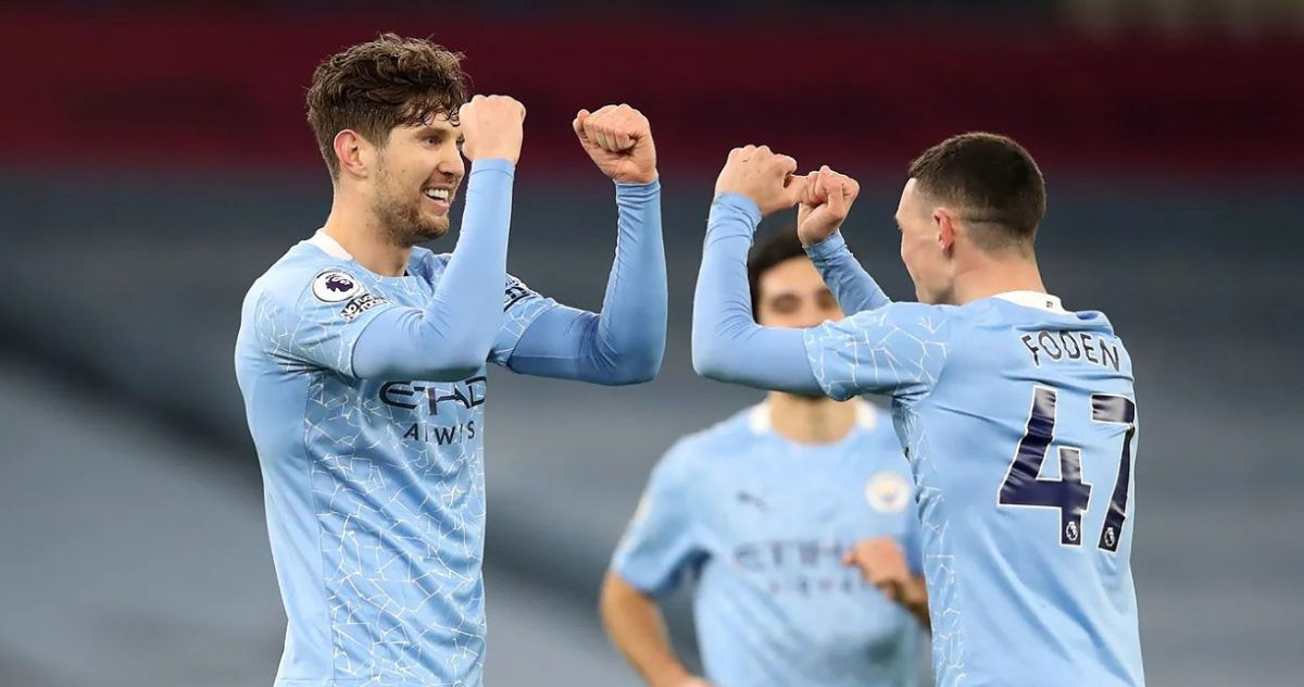 John Stones celebrates after reacting quickest to a Vicente Guaita parry to score his second goal of the match
