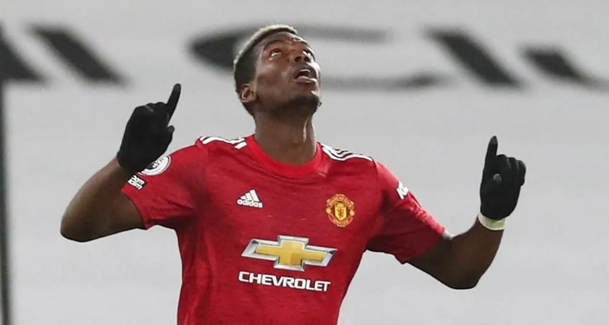 Paul Pogba celebrates after his superb goal puts Manchester United 2-1 ahead at Craven Cottage