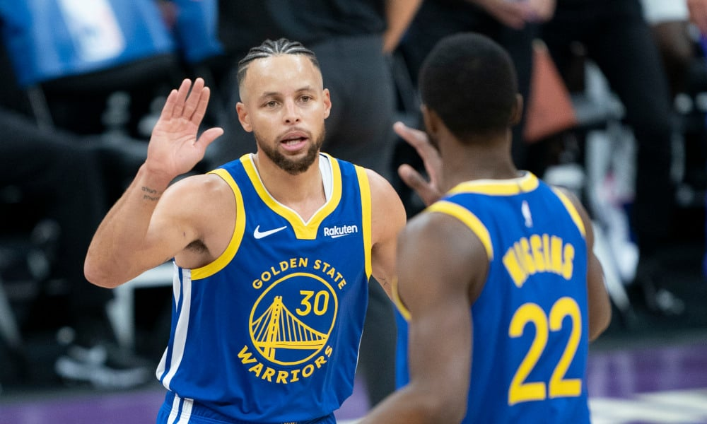 Golden State Warriors guard Stephen Curry (30) celebrates with forward Andrew Wiggins (22) against the Sacramento Kings during the first quarter at Golden 1 Center. Mandatory