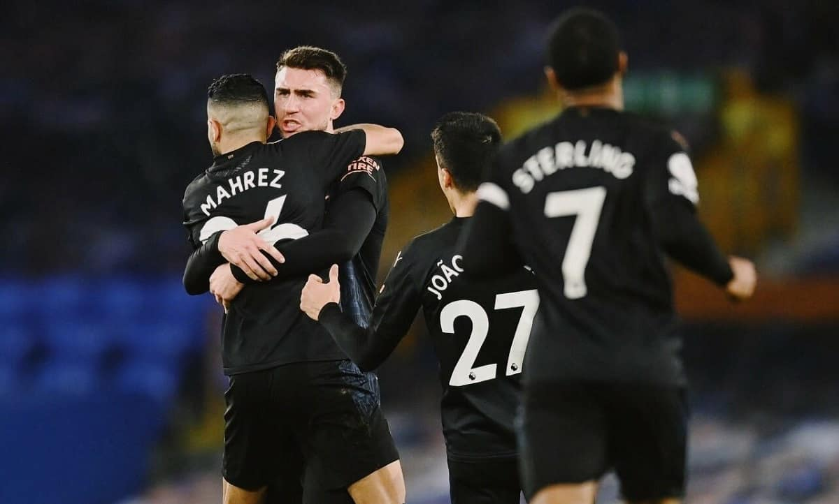 Riyad Mahrez and Aymeric Laporte celebrating during manchester City's 3-1 win over Everton