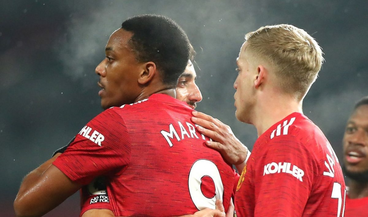 Anthony Martial of Manchester United celebrates scoring his teams fifth goal during the Premier League match between Manchester United and Southampton at Old Trafford on February 02, 2021 in Manchester, England. Sporting stadiums around the UK remain under strict restrictions due to the Coronavirus Pandemic as Government social distancing laws prohibit fans inside venues resulting in games being played behind closed doors