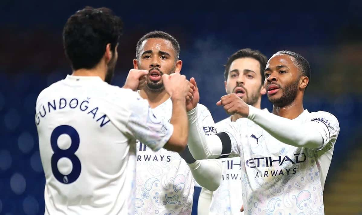 Raheem Sterling celebrates his goal with his team-mates as Man City take a two-goal lead into the halftime interval