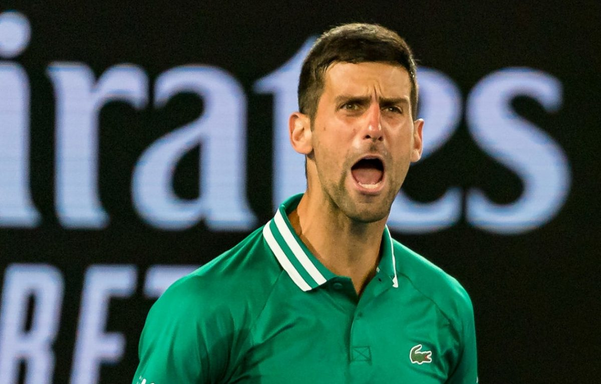 Novak Djokovic of Serbia celebrates match point in an empty Rod Laver Arena during his Men's Singles third round match against Taylor Fritz of the United States during day five of the 2021 Australian Open at Melbourne Park on February 12, 2021 in Melbourne, Australia. (Photo by Andy Cheung/Getty Images)
