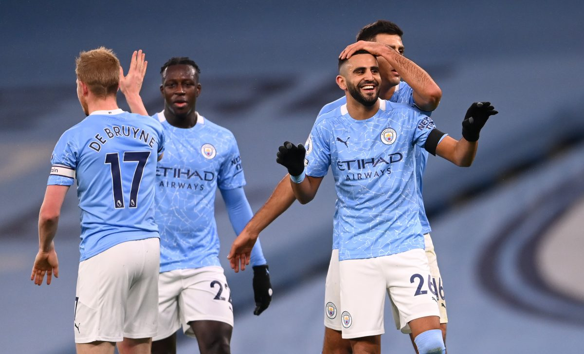 Riyad Mahrez of Manchester City celebrates with teammates Rodrigo, Benjamin Mendy and Kevin De Bruyne after scoring their team's second goal during the Premier League match between Manchester City and Burnley at Etihad Stadium on November 28, 2020 in Manchester, England. Sporting stadiums around the UK remain under strict restrictions due to the Coronavirus Pandemic as Government social distancing laws prohibit fans inside venues resulting in games being played behind closed doors.