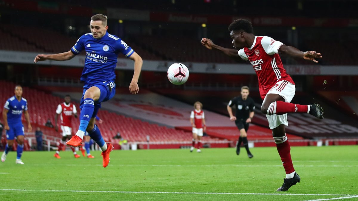 Bukayo Saka of Arsenal shoots during the Premier League match between Arsenal and Leicester City at Emirates Stadium on October 25, 2020 in London, England. Sporting stadiums around the UK remain under strict restrictions due to the Coronavirus Pandemic as Government social distancing laws prohibit fans inside venues resulting in games being played behind closed doors.