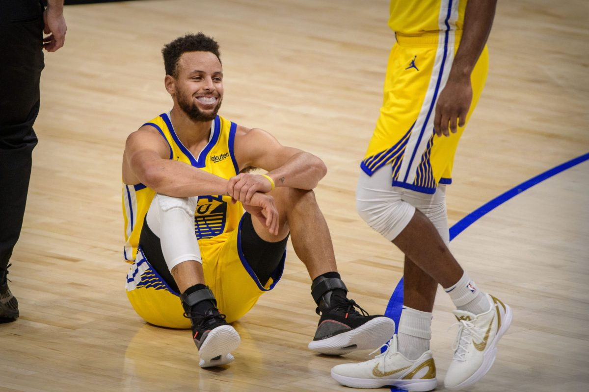 Golden State Warriors guard Stephen Curry (30) sits on the court floor after being called for a foul against the Dallas Mavericks during the first quarter at the American Airlines Center. Mandatory