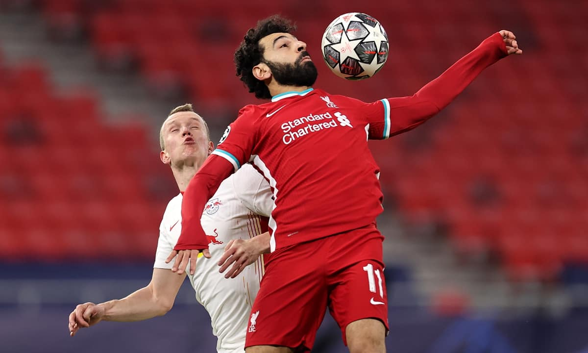 Lukas Klostermann of RB Leipzig battles for possession with Mohamed Salah of Liverpool during the UEFA Champions League Round of 16 match between Liverpool FC and RB Leipzig at the Puskas Arena on March 10, 2021 in Budapest, Hungary. Sporting stadiums around Germany remain under strict restrictions due to the Coronavirus Pandemic as Government social distancing laws prohibit fans inside venues resulting in games being played behind closed doors