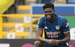 Thomas Partey of Arsenal takes a knee during the Premier League match between Burnley and Arsenal at Turf Moor on March 06, 2021 in Burnley, England. Sporting stadiums around the UK remain under strict restrictions due to the Coronavirus Pandemic as Government social distancing laws prohibit fans inside venues resulting in games being played behind closed doors. (Photo by David Price/Arsenal FC via Getty Images)