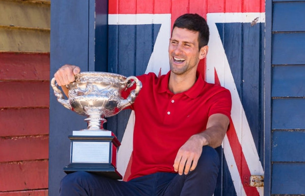 Novak Djokovic of Serbia poses with the Norman Brookes Challenge Cup after winning the 2021 Australian Open Men's Final, at Brighton Beach on February 22, 2021 in Melbourne, Australia. (Photo by Andy Cheung/Getty Images)