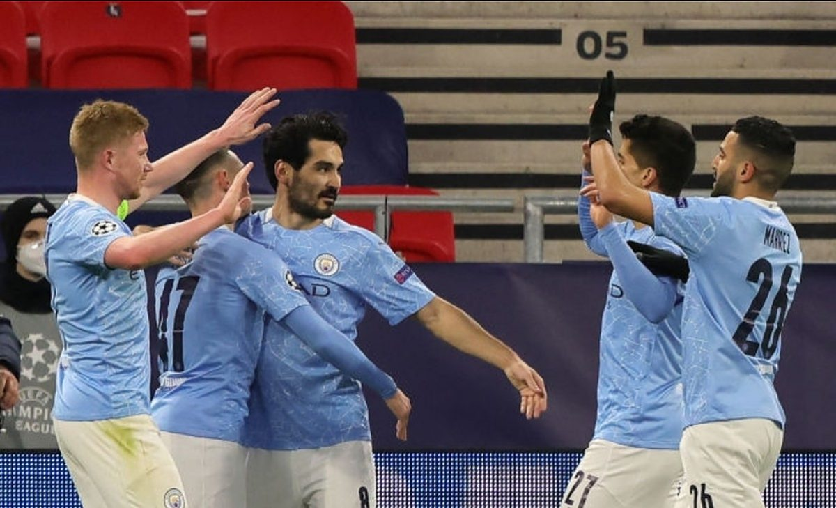 Ilkay Gundogan of Manchester City celebrates with team mates Phil Foden, Kevin De Bruyne, Joao Cancelo and Riyad Mahrez after scoring their side's second goal during the UEFA Champions League Round of 16 match between Manchester City and Borussia Moenchengladbach at Puskas Arena on March 16, 2021 in Budapest, Hungary. Manchester City face Borussia Moenchengladbach at a neutral venue in Budapest behind closed doors to prevent the spread of Covid-19 variants. (Photo by Laszlo Szirtesi - UEFA/UEFA via Getty Images)